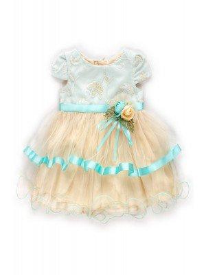 Платье на подкладке,низ из сетки,декорировано брошью