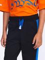 Брюки спортивные зауженные по низу на манжете для мальчика, цвет: черный